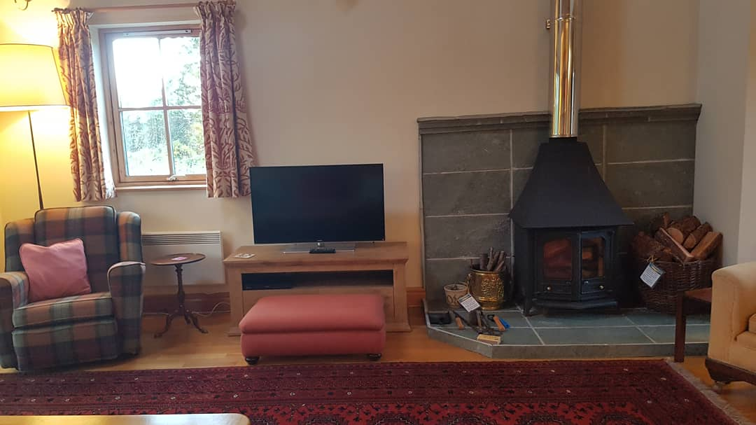 Sitting area wood stove and smart TV